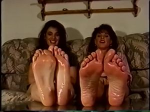 Retro girls showing off their oiled feet