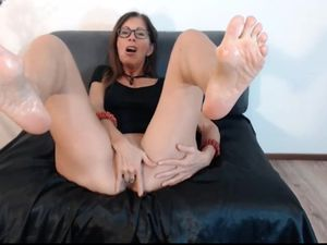 mature slut shows oiled wrinkly soles..
