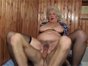 Granny Norma bouncing on a young guys..