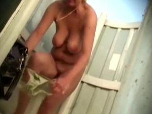 Hot mature woman in beach cabin